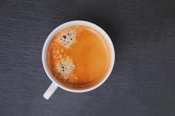 Fotobehang - Cup of fresh coffee on black table