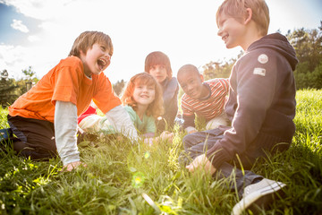 Poster Camping Multiethnic group of happy children playing outside in the nature
