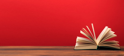 Open book  on red background. text place .