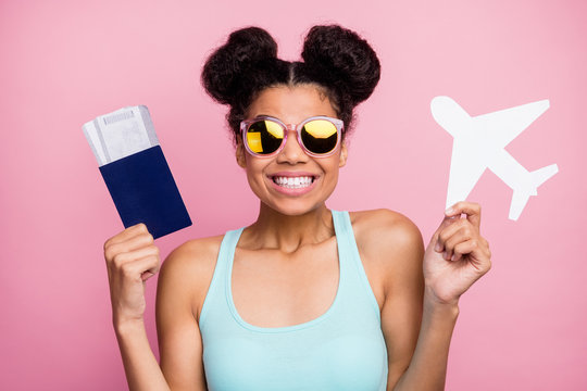 Photo of funny pretty dark skin lady hold paper plane tickets passport airport registration check-in wear sun specs blue teal tank-top isolated bright pink background