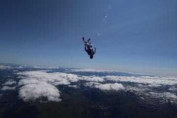 Fotobehang Volle maan Skydiver over Voss Norway