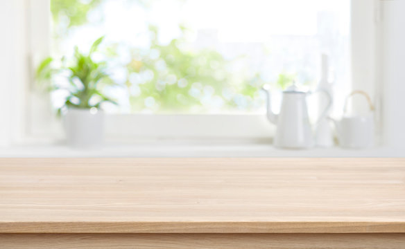 Wooden kitchen table with background of window for product display