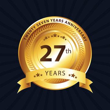 27th anniversary logo with gold ribbon