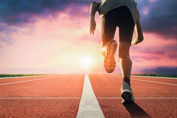 Sports background. Sprinter leaving starting blocks on the running track closeup on shoe. Start line