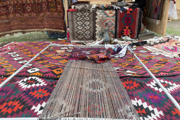 An ancient weaving device. In the East, carpets are woven on it