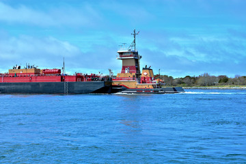 Tugboat and barge entering Cape Cod Canal