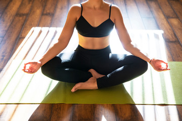 Young girl meditating sitting in lotus position