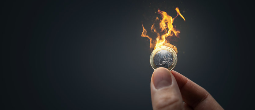 Burning Euro coin panorama