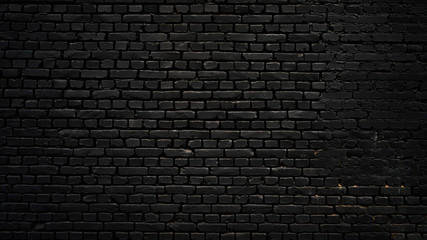 Texture of a perfect black brick wall as background or wallpaper