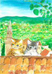 屋根の上にいる子猫