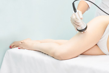 Perfect body radio treatment. Woman at spa procedure. Doctor hand and girl body
