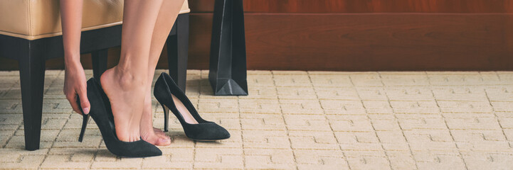 Shoe shopping woman trying on high heels shoes at home online buying fashion footwear stylish suede stilettos clothing panoramic banner header crop of women' s feet. Fotobehang