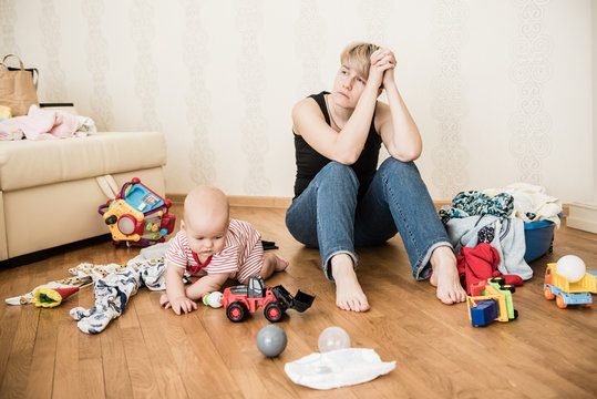 Mom tired to tidy up the house. Child scattered toys. Children's room. Mess in the house