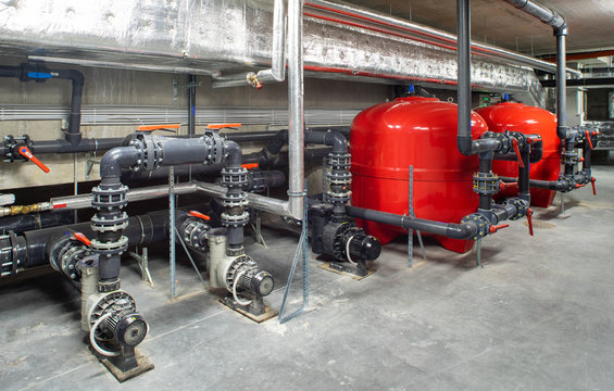 Boiler room. Heating system. Large boiler units. Metal piping system.