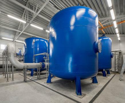 Boiler room. Heating system. Large boiler units. Metal pipe.