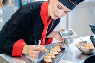 Chef seasoning an appetizer
