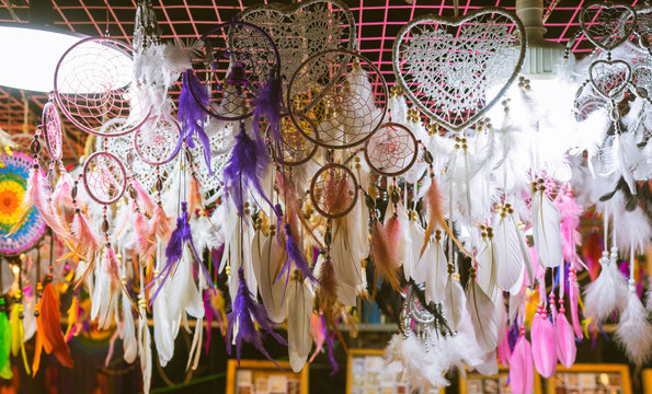 Dreamcatcher, boho chic feathers, ethnic amulet, symbol. With beads of rope hanging. Talisman for a dream. Witchcraft and secrets. Witchcraft and fortune telling
