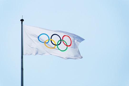 Olympic flag, blue sky background