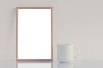 White coffee cup and blank picture frame mock up