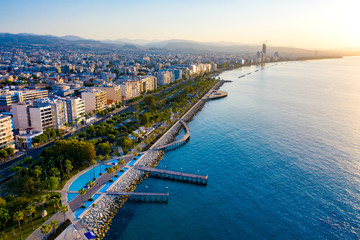 Republic of Cyprus. Limassol promenade from a height. Panorama of the Mediterranean coast at sunset. Sea promenade of Limassol. Molos. Promenade by the Mediterranean sea. Holidays in Cyprus.