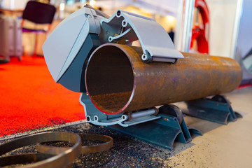 Metalworking. Equipment of Metalworking production. Device for sawing metal pipes. A special clamp ensures immobility of the pipe. Works on replacement of the pipeline.