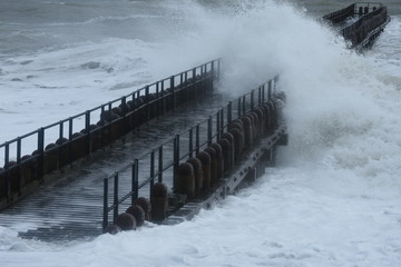 breakwaters on the Dutch coast during a storm with high waves