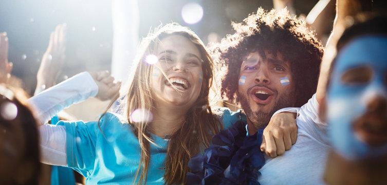 Cheering couple at football match