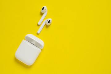 ROSTOV-ON-DON, RUSSIA - October 07, 2019: Apple AirPods wireless Bluetooth headphones and charging case for  Apple iPhone. New Apple Earpods Airpods in box.