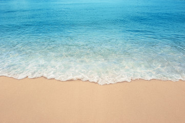 Wall Mural - Summer Sea Sandy beach with clear blue sea Summer background concept