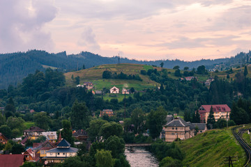 Fotobehang Marokko View of vertex.Carpathian mountains in the midle of summmer. Ukrainian village in the Carpathians on dusk light during the sunset in countyside. Beautiful landscape during the evening light. Summer co