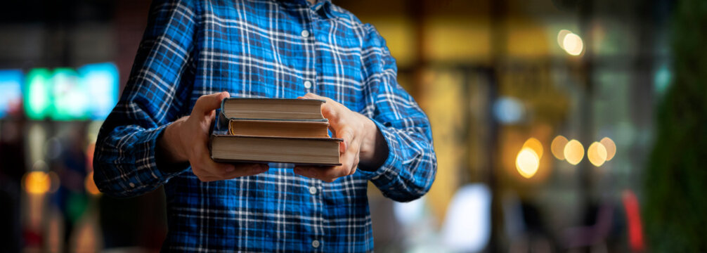 young person holding and giving a book, sharing knowledge and wisdom