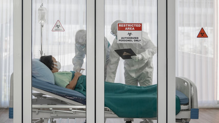 coronavirus covid 19 infected patient in quarantine room with quarantine and outbreak alert sign at...