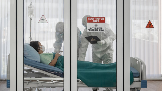coronavirus covid 19 infected patient in quarantine room with quarantine and outbreak alert sign at hospital with disease control experts make disease treatment, coronavirus covid 19 disease treatment
