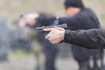 police, army and border police gun training. firing weapons and pistols. gun shooting exercise. detailed shots of gun, bullets and shells.