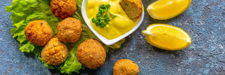 Deep-fried homemade vegetarian falafel made from ground chickpeas and broccoli, with mustard lemon sauce