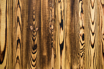 Old wood texture background, wooden boards with knots.