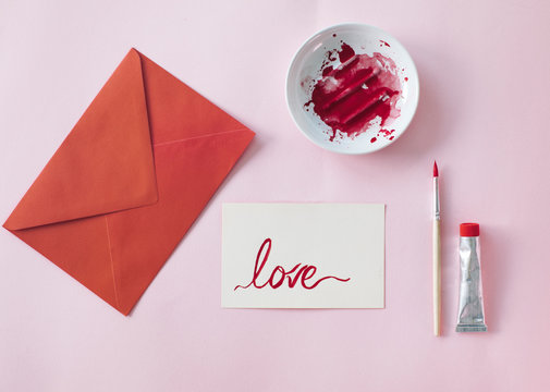 Making a Valetine's day card, red envelope and card with love written on it
