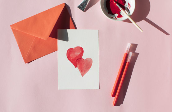 Making a Valetine's day card, red envelope and card with hearts
