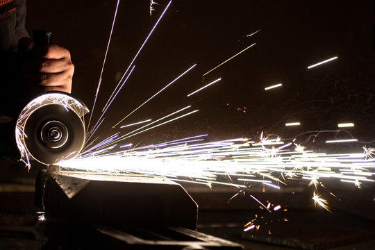 The process of stripping metal using an abrasive wheel on a grinding machine. Sparking is hazardous to the eyes.