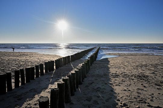 Breakwaters on the beach in Vlissingen Holland