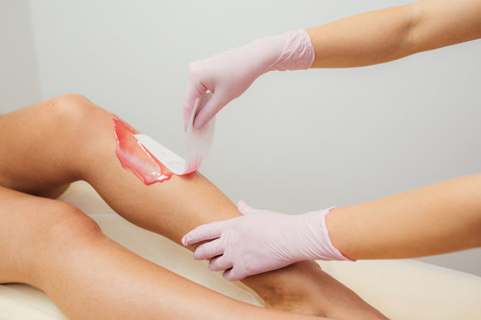 shugaring, applying wax to the surface of the skin