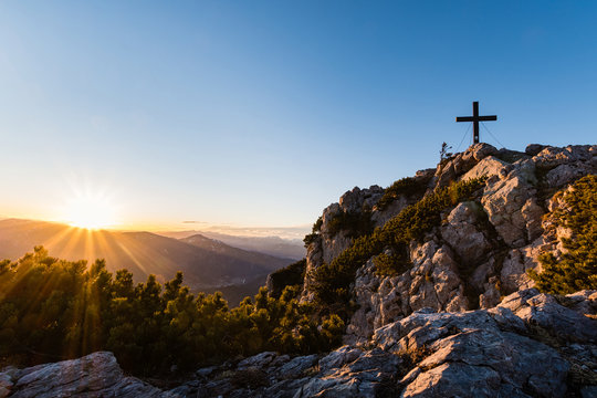 "summit cross at ""Hochlantsch"" mountain in Styria, Austria at sunset"