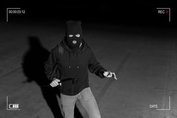 CCTV View Of Thief Standing In Dark Alley - fototapety na wymiar