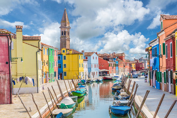 Wall Mural - Landscape with colorful houses, canal, boat and church on the famous  Burano island, Venice, Italy