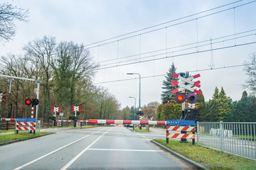Zeist, Netherlands - January 04, 2020. Railroad crossing with red lights