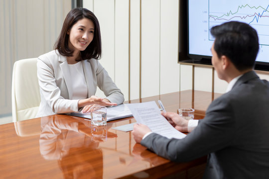 Young Chinese businesswoman in job interview
