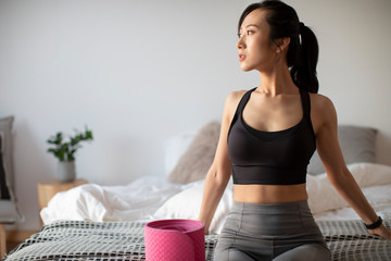 Young Chinese woman exercising in the morning