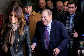 Film producer Weinstein smiles as he exits the New York Criminal Courtroom with his defense attorneys Rotunno and Cheronis after the second day of jury deliberations in his sexual assault trial in the Manhattan borough of New York City, New York