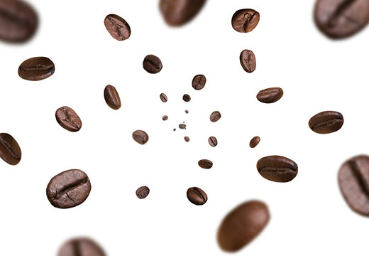 Dark brown roasted coffee beans flying falling on white background. Concept for coffee product advertising. Selective Focus.