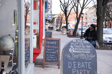Signs outside the campaign office of presidential candidate Bloomberg welcome members of the public to watch the democratic debate in Brooklyn